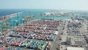 Aerial view of industrial port with containers. Drone shot of modern industrial port in Barcelona with cargo containers. Import and export cargo terminal with stock video footage
