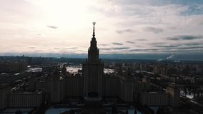 Drone shot of Moscow State University building silhouette, snow covered park stock footage