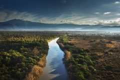 Drone shot of the river which divides the Patara National Park in two at sunset time stock photography