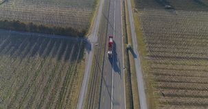Drone shot of road with industrial traffic. Drone shot of truck driving in a countryside road stock footage