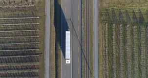 Drone shot of road with industrial traffic. Drone shot of truck driving in a countryside road stock video
