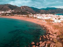Drone shot of a small town in Greece with 2 beaches royalty free stock image