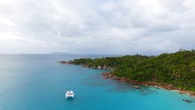 Aerial View Of Yacht In The Indian Ocean, Seychelles. Drone Shot Of Yachts In The Indian Ocean, Anse Lazio,Praslin Island, Seychelles stock footage