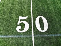 Drone Shot Of The 50 Yard Mark On An American Football Field stock photos