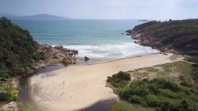 Drone shows lagoon sandy beach on rocky coast stock footage