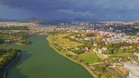 Drone Shows Panoramic View Nice Lake among City against Sky stock footage