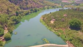 Drone Shows River among Tropical Landscape Highlands. Drone removes and shows beautiful river with rapids between tropical landscape and highlands in Vietnam stock footage