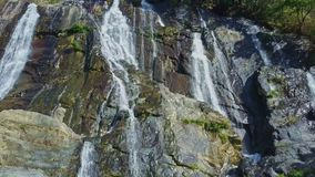 Drone Shows Waterfall Follows River Cascade against Blue Sky stock video