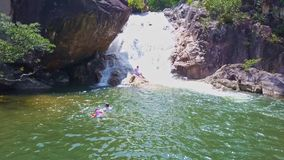Drone Shows Wonderful Waterfall and People Swimming stock video footage