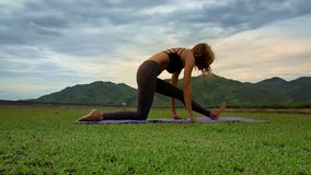 Drone Side View Woman Holds Yoga Position against Hills stock video