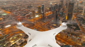 Drone silhouette flying above modern city Stock Photo