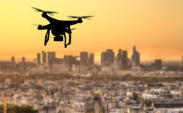 Drone silhouette flying above Paris city panorama Royalty Free Stock Image