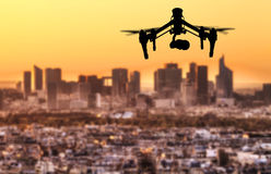 Drone silhouette flying above Paris city panorama Royalty Free Stock Images