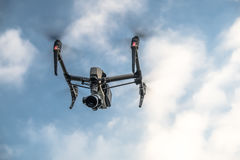 Drone silhouette flying in the evening sky Royalty Free Stock Photography