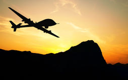 Drone silhouette. Drone flying over mountains on sunset background. Illustration royalty free illustration