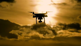 Drone silhouette flying in sunset landscape stock video