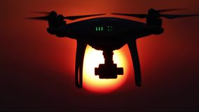 Drone silhouette, orange sunset, 50 fps, four video scenes stock footage