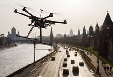 Drone in the skies of Moscow. A flying hexacopter without a camera shot from a side with the a blured silhouette of Moscow in the background Royalty Free Stock Photos