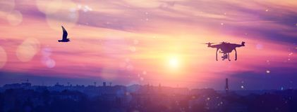 Drone in the sky at majestic colorful sunset. over the evening citi. soft light effect,. Instagram toning effect stock photo