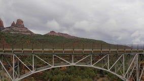Drone slowly rising over Midgley Bridge in Sedona, Arizona