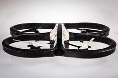 Drone. A small spy quad copter drone with a camouflage hull stock images