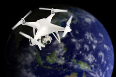 Drone in space. Drone with camera in space above Earth, photo of the earth from Nasa stock photography