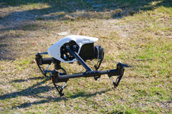 Drone with spinning props preparing for takeoff Royalty Free Stock Photos