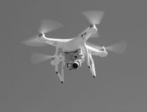 Drone spy camera black and white. A flying drone with a video camera spying form above. Taken in black and white. 2016 royalty free stock photography