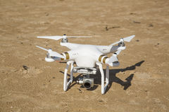 Drone standing in the sand at the beach Royalty Free Stock Photo