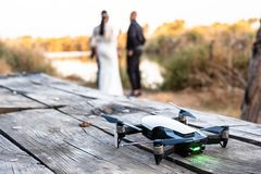 Drone standing on the table with wedding couple in nature