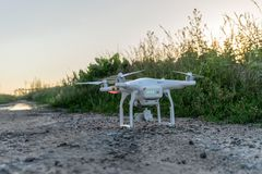 Drone before starting. In front of a field edge in the evening light Stock Image