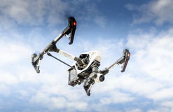 Drone with surveillance camera flying out of sky cloud Royalty Free Stock Photo
