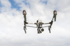Drone with surveillance camera flying out of sky cloud Stock Photography