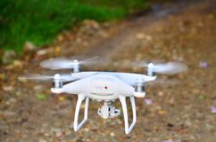 Drone take off from land and flying above rock road. Drone take off from land and flying above rock road for take aerial photo. at sunrise morning royalty free stock photography