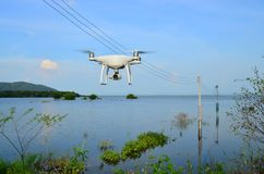 Drone take off from land and flying for take aerial photo. Stock Photos
