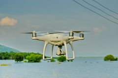 Drone take off from land and flying for take aerial photo. at su Stock Image