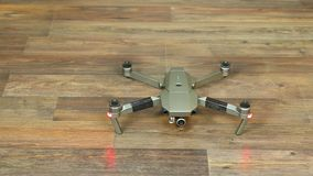 Drone taking off indoors. Foldable drone taking off indoors stock video footage