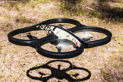 Drone taking off. A small spy quad copter drone with a camouflage hull taking off stock photography