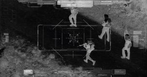 Drone with thermal night vision view of terrorists with camera zooming in. Military drone night vision thermal view of terrorists walking through a forest stock footage