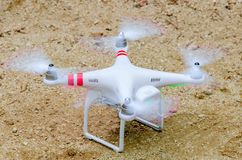 Drone About to take off. A modern drone in white about to take off from the ground royalty free stock images