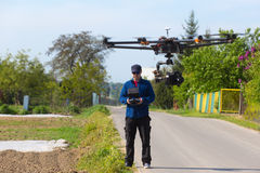 Drone, Unmanned copter flight, pilot flying drone stock photos