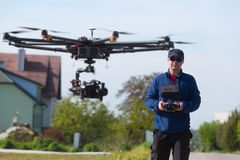 Drone, Unmanned copter flight, pilot flying drone stock photography