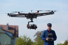 Drone, Unmanned copter flight, pilot flying drone stock image