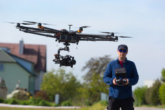 Drone, Unmanned copter flight, pilot flying drone stock photo