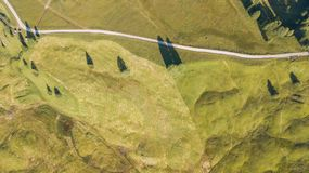 A drone vertical perspective of the meadows at high altitudes, forming soft hills. Dolomites, Alta Badia, Sud Tirol, Italy. Summer time stock images