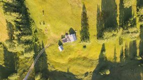 A drone vertical perspective of the meadows at high altitudes, forming soft hills. Dolomites, Alta Badia, Sud Tirol, Italy. Summer time royalty free stock photography