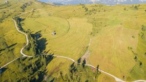 A drone vertical perspective of the meadows at high altitudes, forming soft hills. Dolomites, Alta Badia, Sud Tirol, Italy. Summer time royalty free stock image