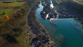 Drone video - Flight over the gorge to the waterfall stock video footage