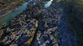 Drone video - Flight over the waterfall across the gorge stock video