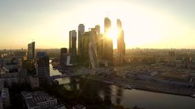 Drone video of Skyscraper at the sunset over the Moscow river stock video footage